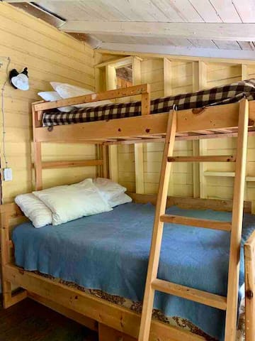 Main floor bedroom with double and single bunk bed