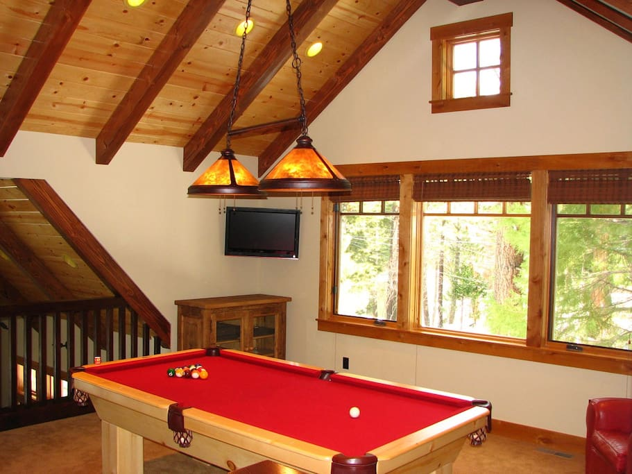 Loft with pool table and tv