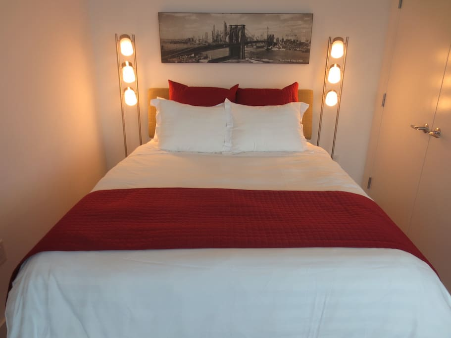 Sleeping area features a queen size bed and a large closet