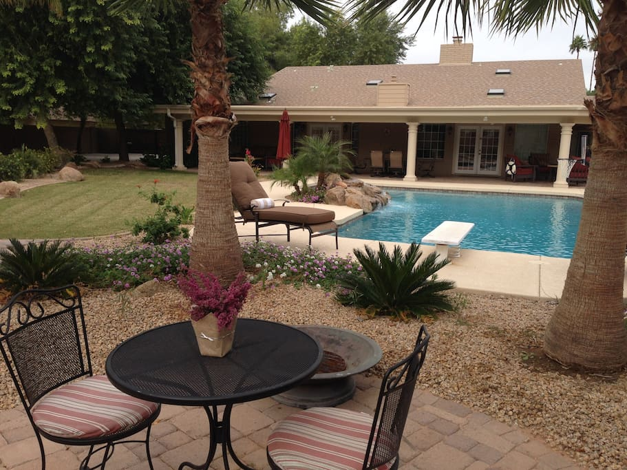 Gorgeous diving pool is all yours, along with chaise lounges and luxurious cushions and towels.