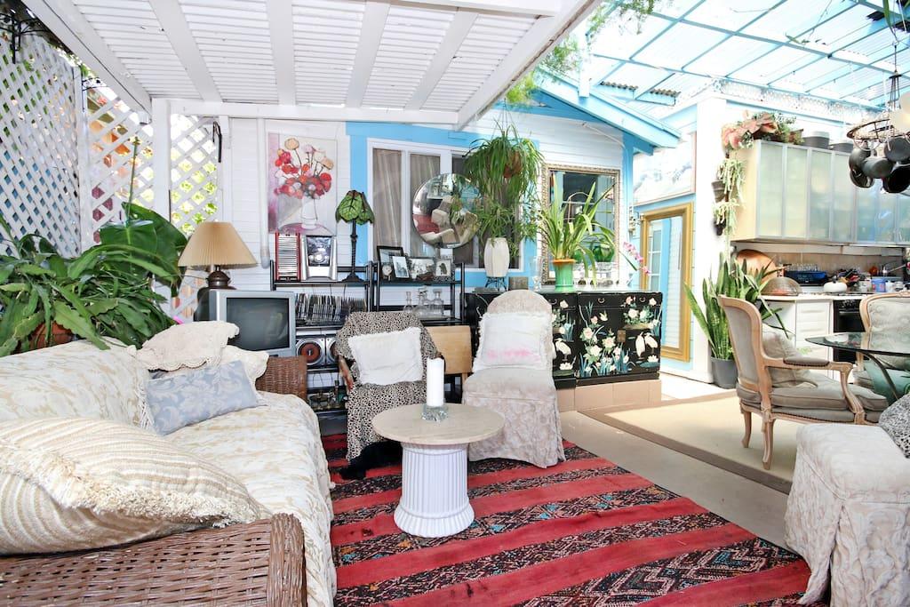 Outdoor living room with blue window of casita