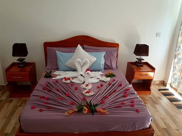 Queen size bed set up for Honey Moon guests.
