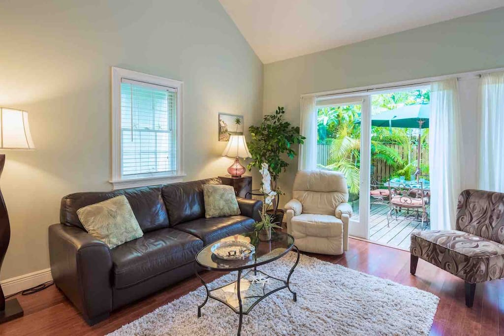 The living room features two sets of French doors that open to the back deck...