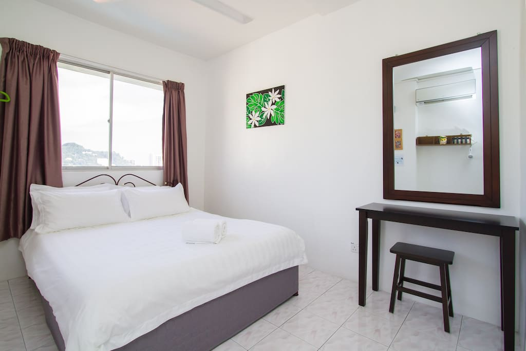 Bedroom with attached bathroom.  1) King Size-King Koil bed Sleeps 2 2) large Mirror 3) Dressing/ writing table 4) Towels provided 5) With air conditioner and fan 6) Equip with Salon Style Hair Dryer 7) Iron Provided