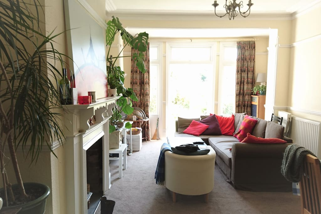 large bright living room with French windows onto patio/garden