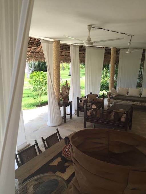 Veranda where you can relax and dine with pool and garden view.