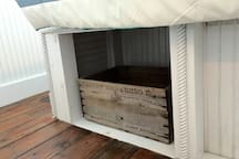 You'll find reclaimed & antique furnishings throughout the boat. This is under-bed storage.