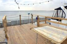 Deck overlooking Charleston Harbor, & the bridge.