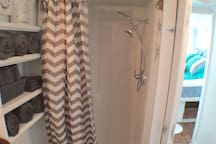 Full sized shower with 2 shower heads, 12 gallon water heater (good for a 20+ minute shower) and great water pressure.