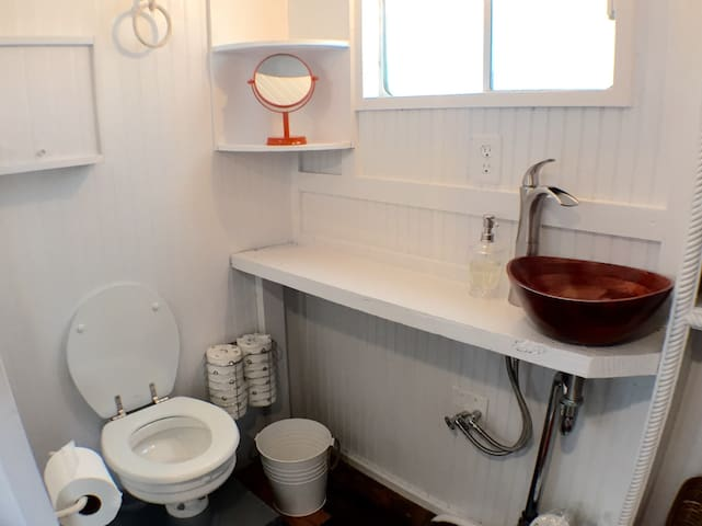 Full working bathroom (just like a traditional house) with lots of natural light & full-sized shower & toilet.
