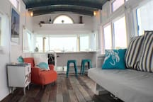 Living room as viewed from the galley (kitchen) featuring a gorgeous reclaimed floor.