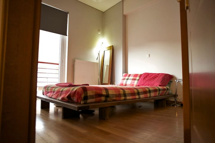 bedroom / double bed / small balcony