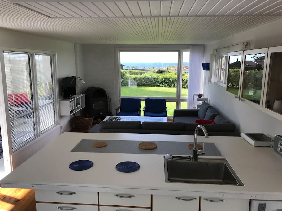 Open kitchen with seating - sitting area with stove and nice seaview.