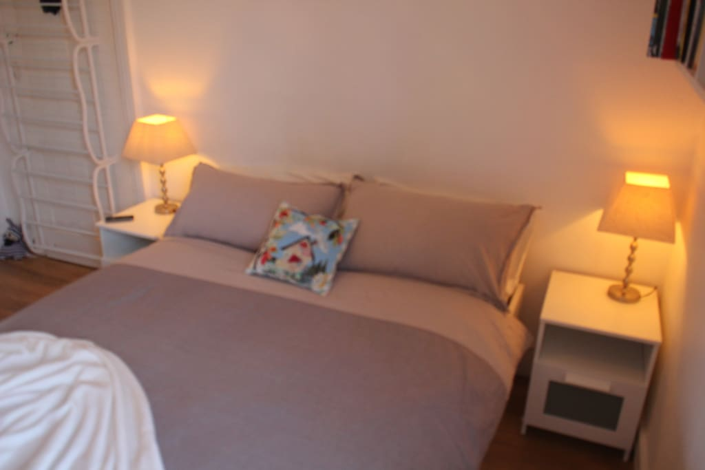 Soothing soft colours with bedside lamps and tables