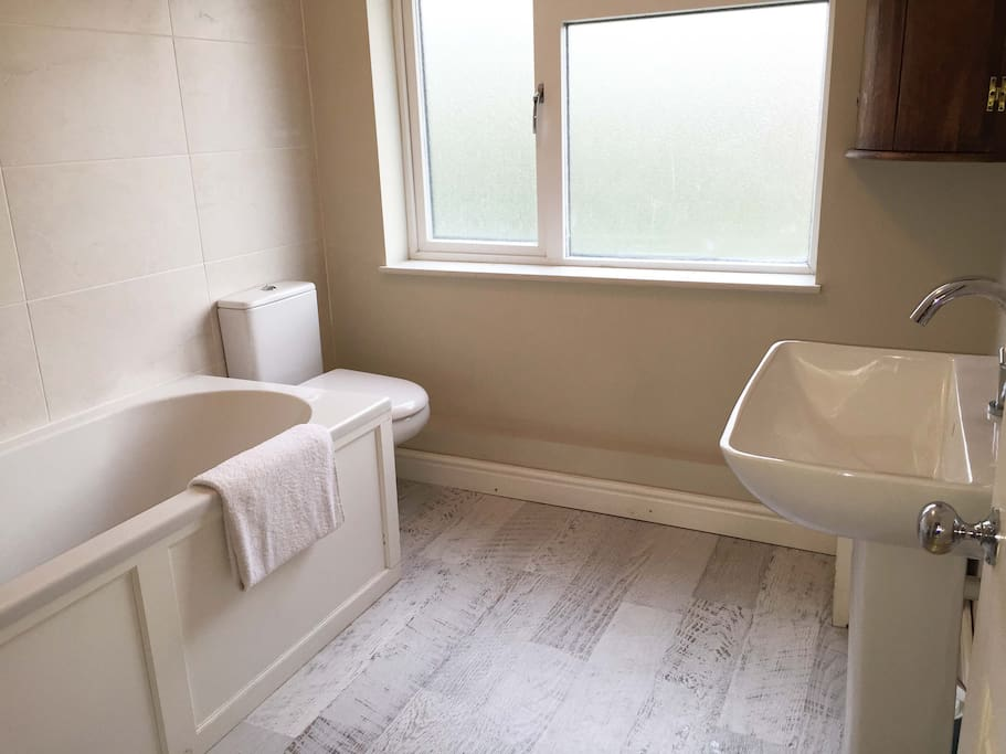 Family bathroom. Clean and spacious with bath and shower.