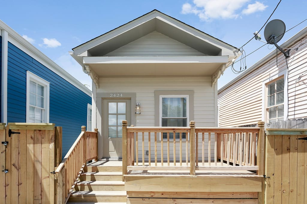 Front of the house, with a new wooden deck for al fresco hang-outs and a street view.