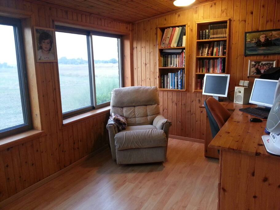 Relaxing office with a lovely view, computer and printer. Can add two beds to this room.