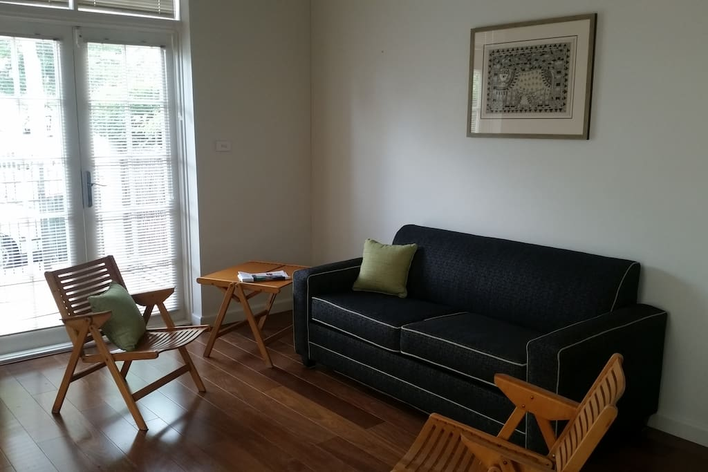 Downstairs, a light-filled open plan space includes a brand new double sofa bed with high quality mattress.