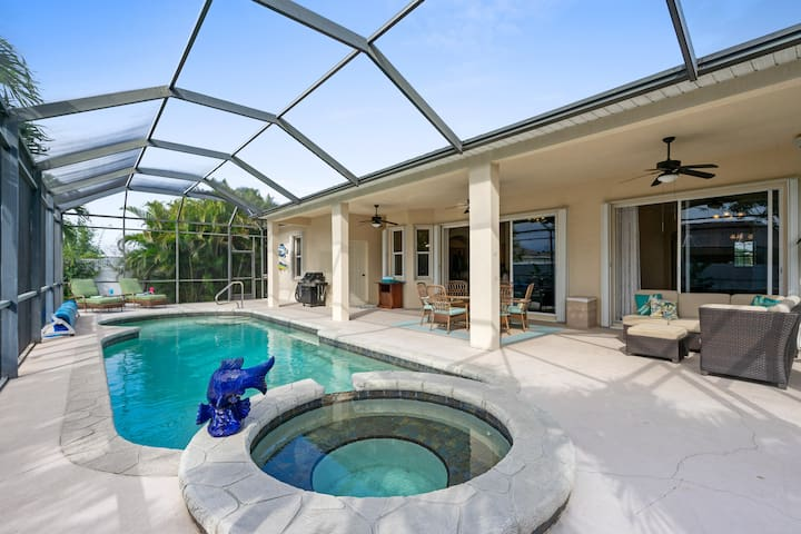 The screened patio features a saltwater pool and spa.