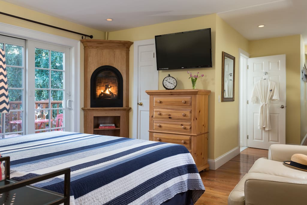 Flat screen TV with DVD player and cozy fireplace