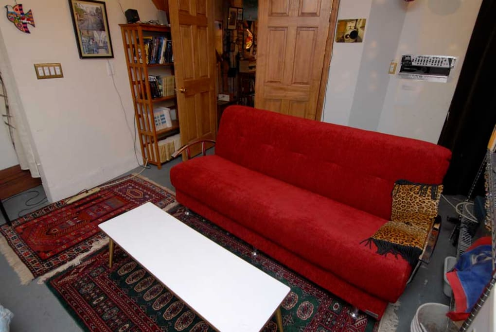 The guestroom couch. It folds down flat into a bed, if needed. My walk-through office is past the double doors. From there, stairs go up to the front door.