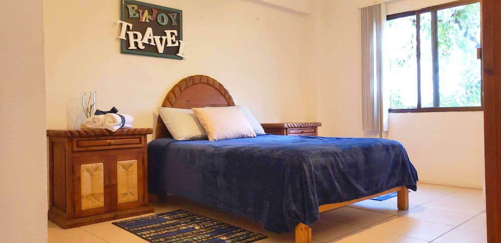Comfortable & Spacious Room with Air Conditioner