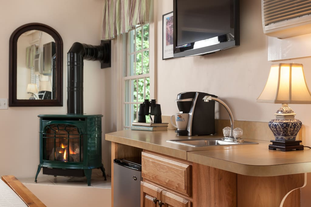 a fireplace, wet bar with microwave, refrigerator, and a 32 inch flat screen LCD TV, with built-in DVD