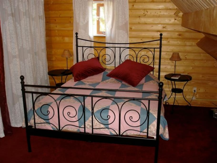 The double bed in the bedroom