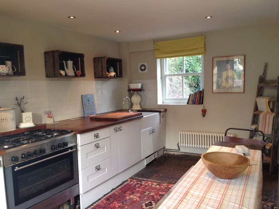 Farmhouse kitchen with butler sink, range cooker, and original cobbles