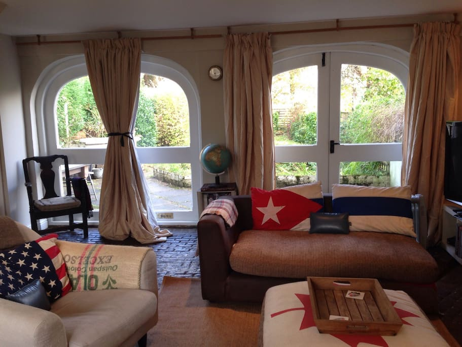 """Living room with original arches from Volcano's history as a Coach House. Review: """"They've thought of all the little touches and we felt very welcome. This is pretty much our ideal holiday home!"""""""