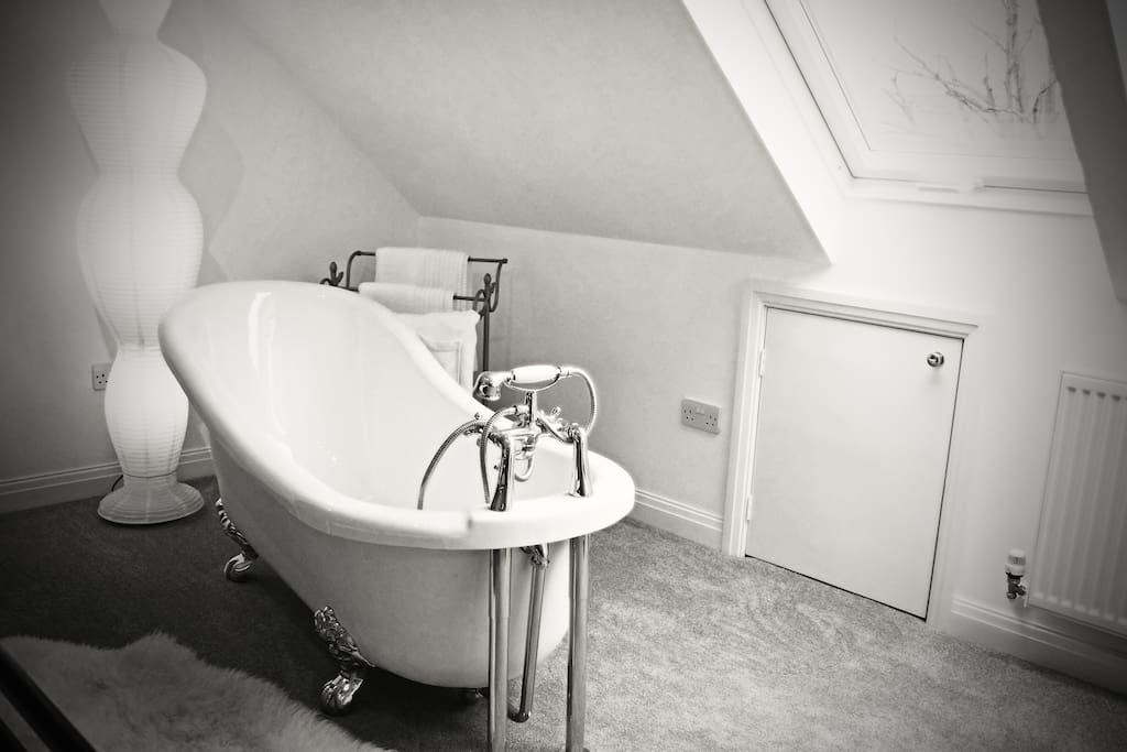 Roll Top Bath at the foot of the Bed
