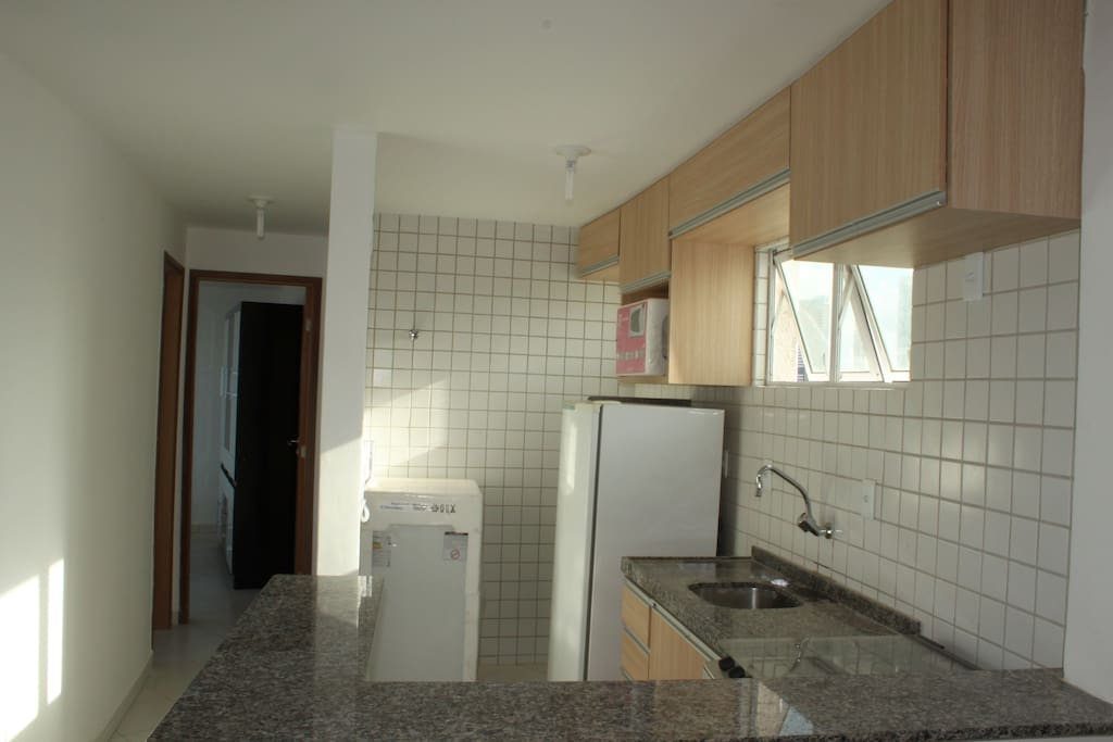 Fully equipped kitchen and service area. Oven, Microwave and washer for clothes.