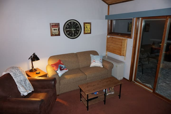 Living room features sofa sleeper to accommodate up to six guests.