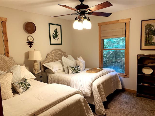 The downstairs bedroom has 2 Full, comfy Beds with a sound machine + full bathroom right next door!