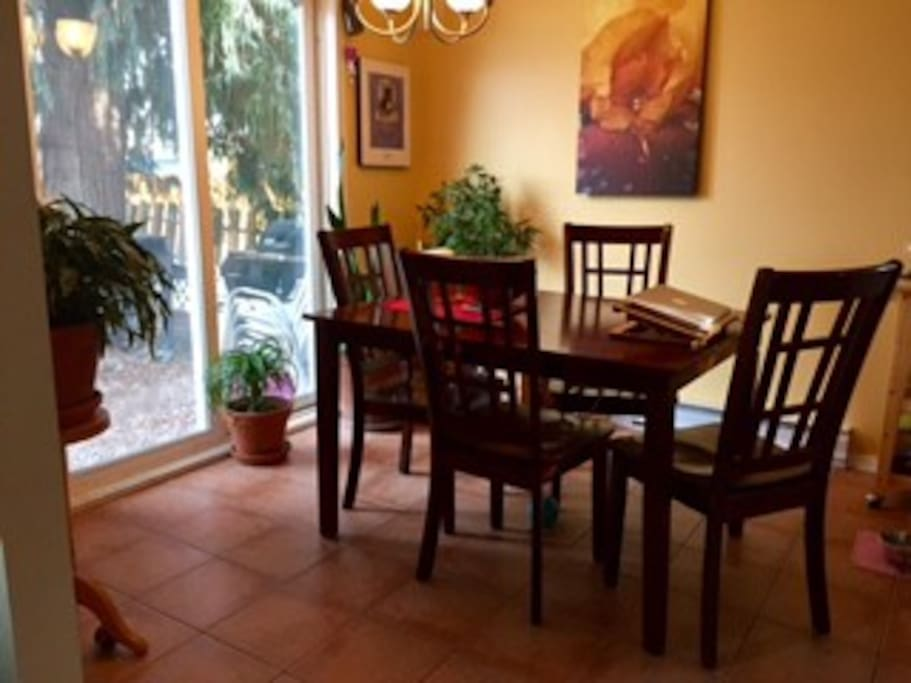 Dining room with sliding door to yard, with more seating and bbq area.