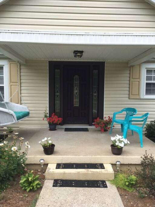 Front door with nice porch area for sitting outside.