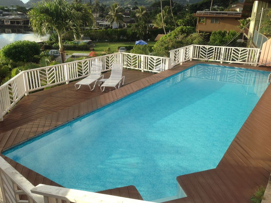 Fully fenced for safety, steps down to the sundeck allow swimmers to still enjoy the view
