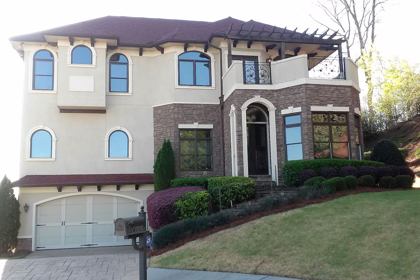 4 level Mediterranean Estate with stone driveway and stairs leading to you Mediterranean Oasis