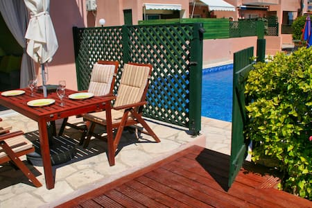 Spacious poolside townhouse with private garden.
