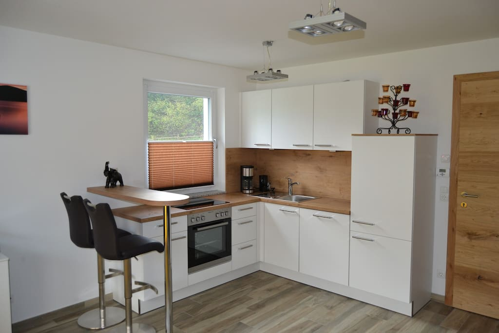 Kitchen with separate bar to help cooking or for a chat.