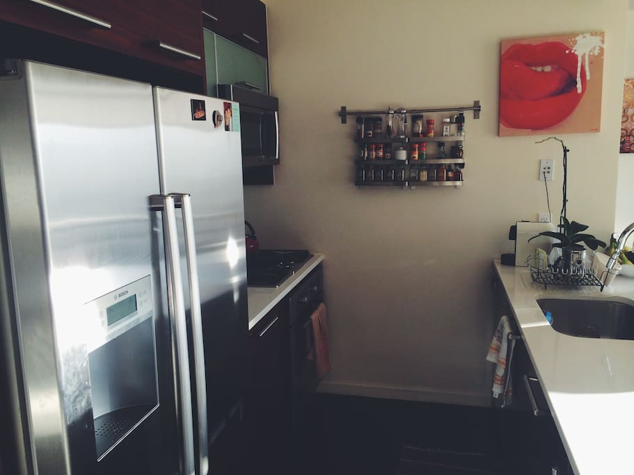 Brand new appliances and spotless kitchen.