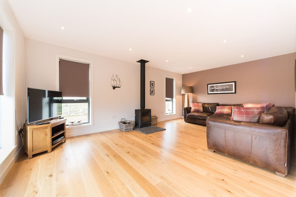 Spacious living area with combusion fire, huge TV, Satellite TV and complimentary WiFi.