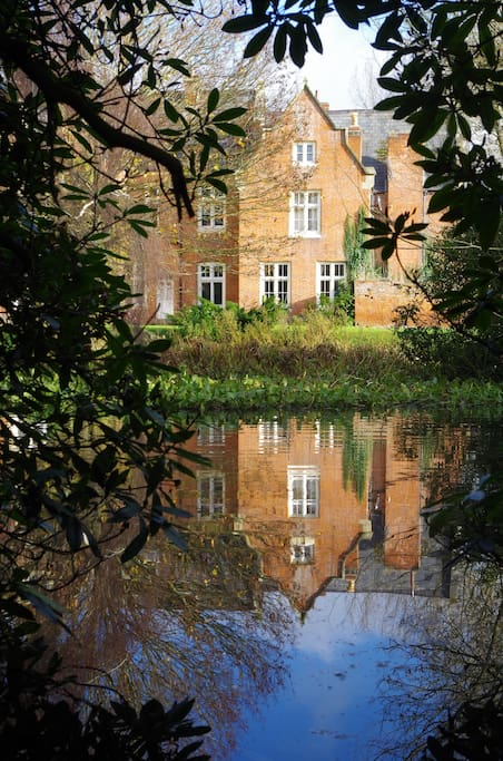 Rear View of House Reflected on Pond