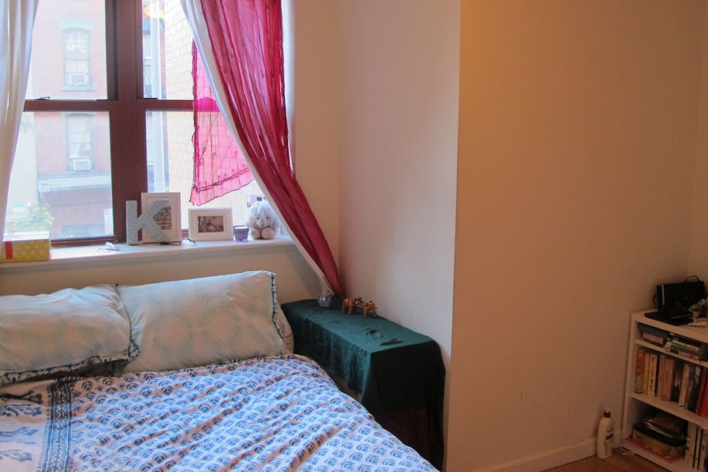 Bedroom 1 with double bed and bright windows