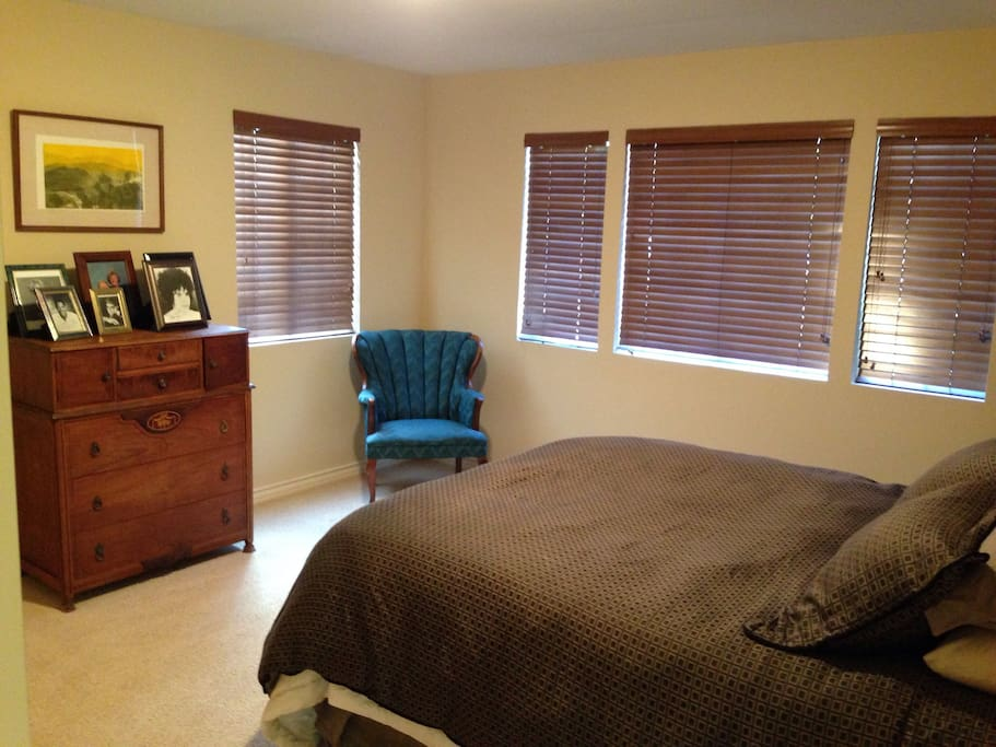 Bedrooms have wooden blinds and down pillows.