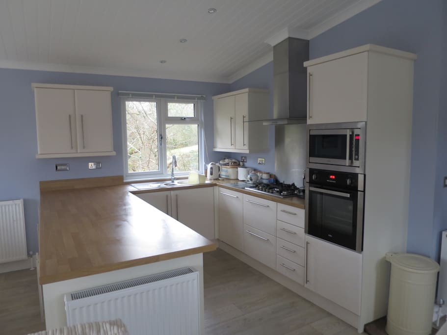 Fully equipped kitchen with dish washer, washing machine, Nespresso coffee machine and Nutribullet smoothie maker for your use.