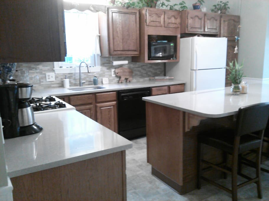 Kitchen has stove, dishwasher, microwave, coffee maker, refrigerator, dishes and cookware - all you need.