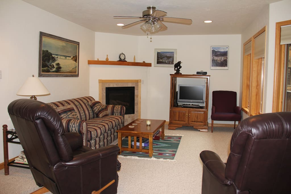 Comfortable living area with Lazy Boy recliners, tv, internet  and gas fireplace and endless views.