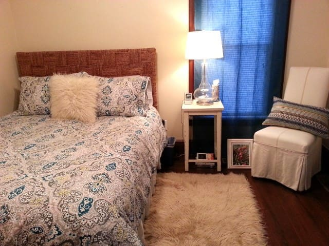 Cozy wool flokati rug & warm flannel sheets in the Fall/Winter.  100% cotton sheets in the Spring/Summer