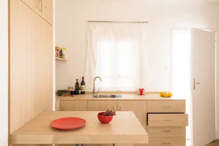 The kitchen is modern and practical, kitted out with all the utensils one might need during their stay and plenty of work space.